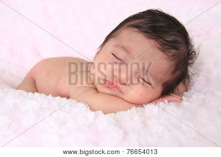 Newborn baby girl of Caucasian and Asian heritage.