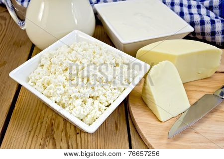Curd with cheese and napkin on board
