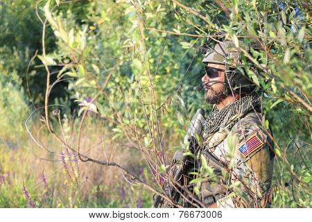 American Soldier In The Bushes