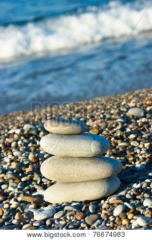 pile of pebbles against the background of the surf