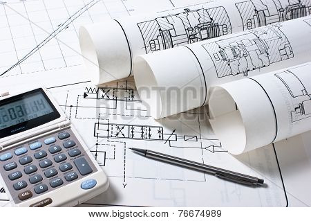 Working with design drawings in pencil on the table