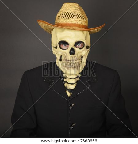 Skeleton In Straw Hat