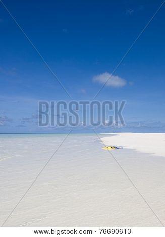 Yellow flippers on the white Maldivian beach, Kuramathi island