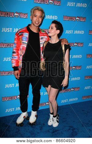 LOS ANGELES - MAR 26:  Jared Eng, Rose McGowan at the Just Jared's Throwback Thursday Party at the Moonlight Rollerway on March 26, 2015 in Glendale, CA