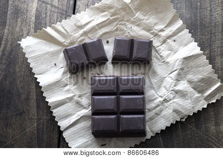 Noble Dark Chocolate On A Wooden Table