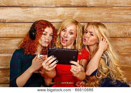 Sisters Make Fun Selfie, Listening To Music On Headphones