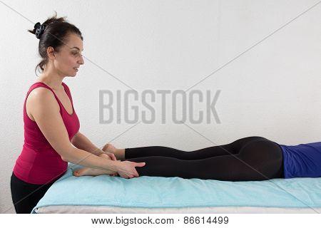 Young Woman Having A Shiatsu Massage By A Woman Therapist