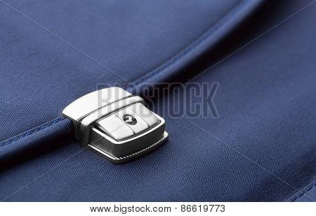 Closeup of blue briefcase clip