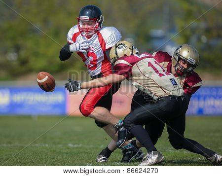 WINDEN, AUSTRIA - APRIL 12, 2014: RB Thomas Weis (#23 Spartans) loses the ball