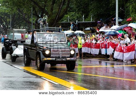 SINGAPORE MARCH 29:Gun carriage bearing the coffin of ex prime minister of Singapore, Mr Lee Kuan Yew driving pass the public on rainy day of state funeral Mar 29 Singapore 2015