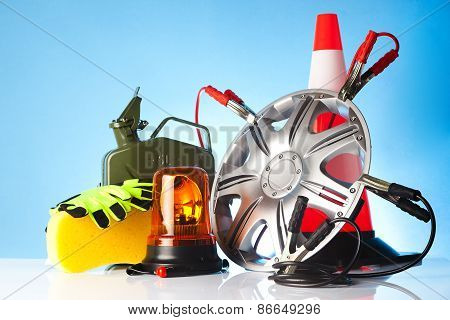 car accessories with fuel can and traffic cone poster