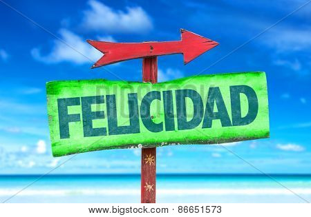 Happiness (in Spanish) sign with beach background