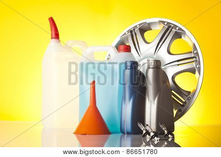 alloy wheel and windshield washer fluids and bottles of motor oil poster