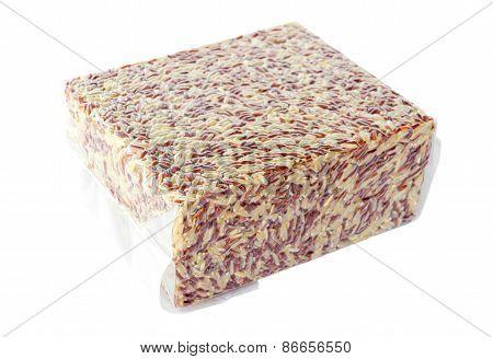 Brown Rice In Vacuum Plastic Bag.