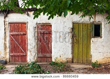 Three old wooden plank vintage doors