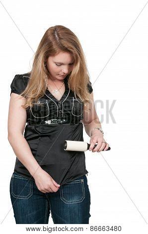 Woman Using Lint Roller