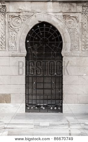 Old Locked Door With Arabic Patterns Relief Decoration