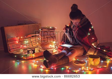 Well-read Girl At Home. Night Exciting Reading