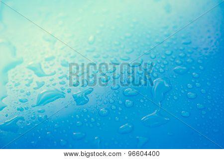 Drops of water on blue floor