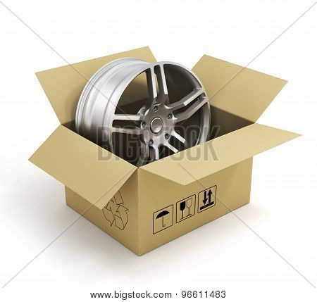Open Cardboard Box With Car Rims On White Background. Online Store Of Auto Parts.