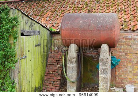 Rusty Oil Tank On Concrete Supports