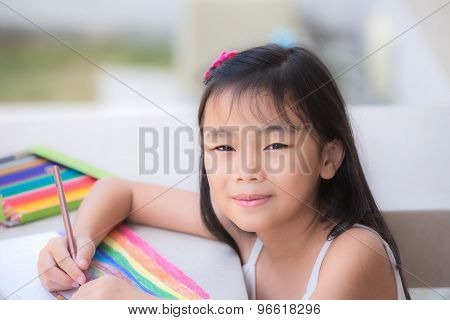 Asian Cute Little Girl Studying