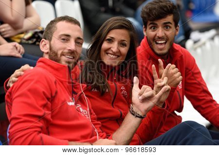 MOSCOW, RUSSIA - JULY 19, 2015: Gerard Rodriguez (left), Pilar Escandell (center), and Antomi Ramos-Viera of Spain during the Beach Tennis World Team Championship. This year Spain won bronze medals