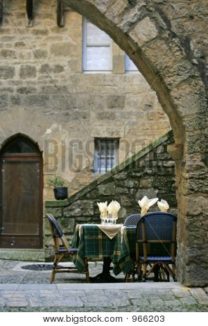 nice terras in france between old buildings poster