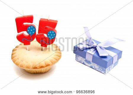 Cupcake With Fifty Five Years Birthday Candle And Gift On White