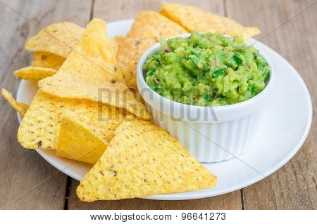 Cup With Chunky Guacamole Served With Nachos