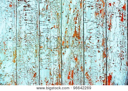 Grungy wood planks wall texture with blue peeling paint