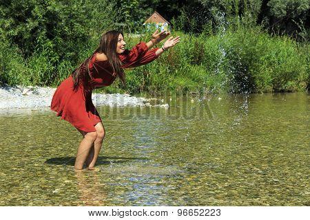 Girl splashing with water