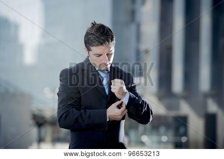 Businessman Adjusting Shirt Cuff Link Outdoors Exterior Office Building