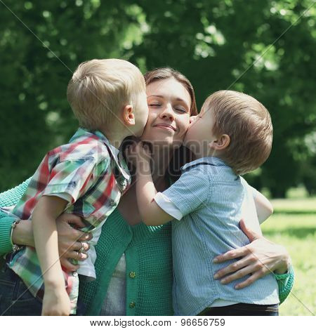 Moment Of Happy Mother! Two Children Sons Kissing Mom, Mother's Day