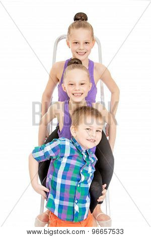 Children sitting on building stairs