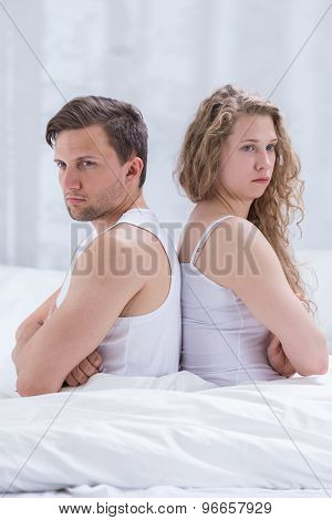 Image of disagreement beetwen frustrated wife and husband poster
