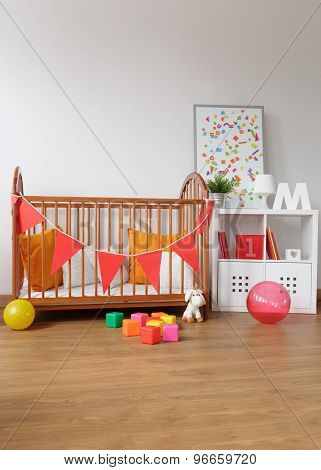 Picture of contemporary wooden furniture in babygirl room poster