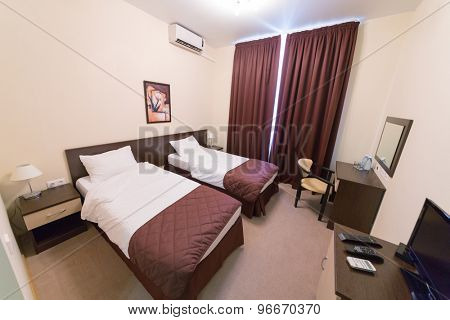 ADLER, RUSSIA - JULY 29, 2014: interior of a hotel room with two beds in Barkhatnye Sezony Chistye Prudy Resort