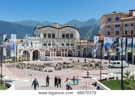 ESTOSADOK, RUSSIA - AUGUST 1,2014: workers laid paving slabs in courtyard of Gorky Gorod Apartments