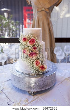 Three tiered vintage wedding cake with roses