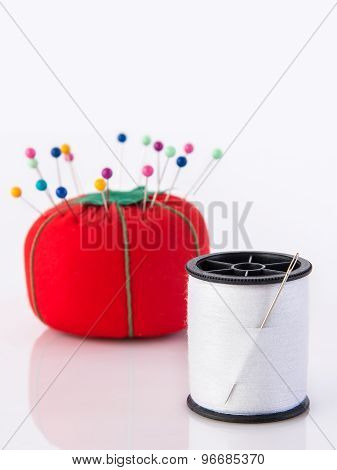 White Thread And Red Cushion
