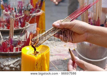 The Woman Is Incensing Bundle Of Joss Stick