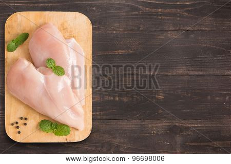 Raw Chicken Breast Fillets On Wooden Background With A Lot Of Copy Space For Your Text Or Editing