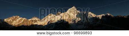 Sunset over Mount Everest (8,848 m) and Mount Nuptse (7,861 m) in Khumbu region, Himalayas, Nepal.
