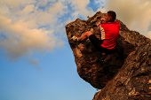 climber climbing on rock.  Strong male climber with copy space poster