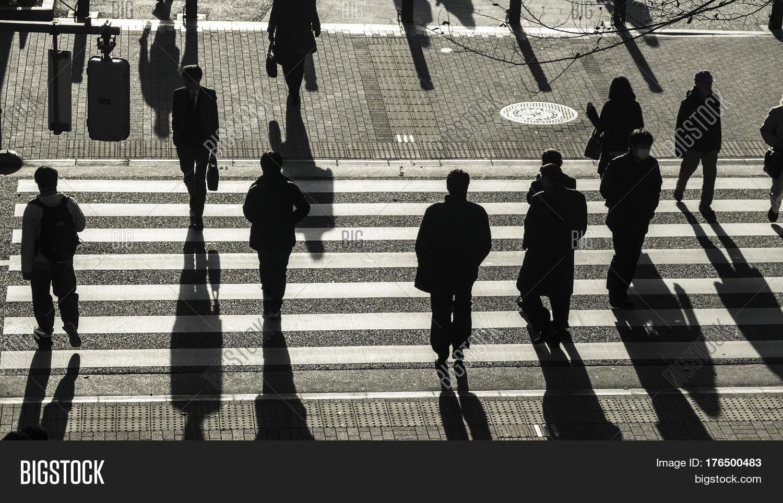 Silhouette Of People Walking On Street: Silhouette People Walk On Image & Photo