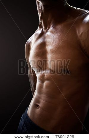Macho man abdominal muscles isolated black background