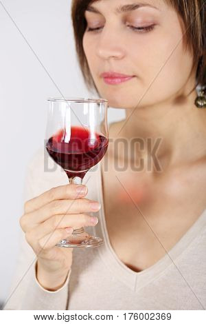 Young woman tasting pink wine. Glass closeup