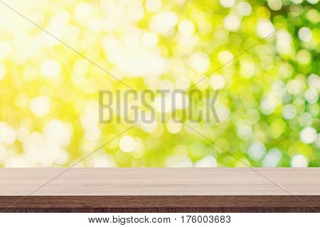 Empty Wooden Table For Product Placement Or Montage And Green Boken Blurred Background.