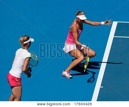 MELBOURNE, AUSTRALIA -JANUARY 28: Victoria Azarenka of Belarus (R) with partner Maria Kirilenko of Russia in the women's doubles final at the Australian Open on January 28 2011 in Melbourne, Australia